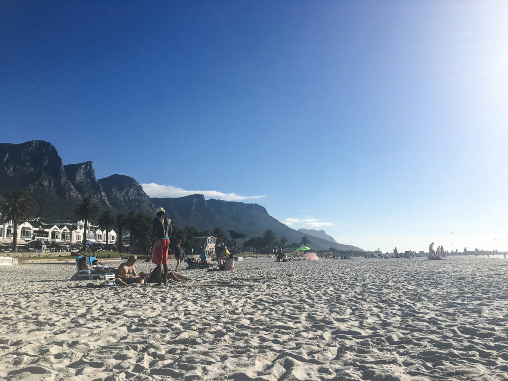 people at camps bay beach