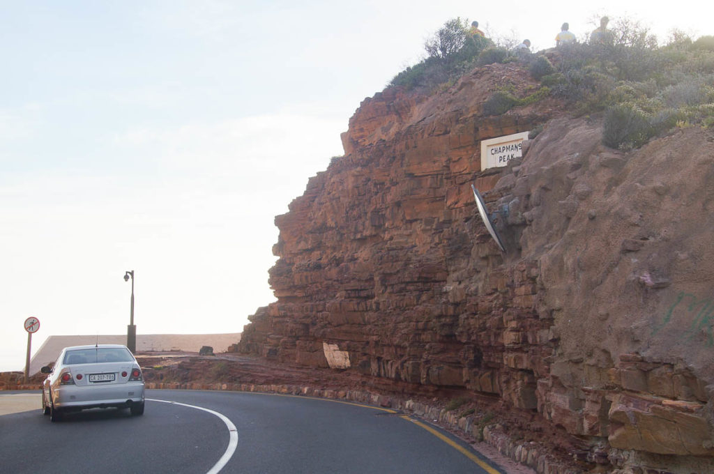 car passing Chapmans Peak Drive