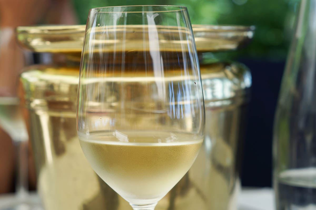 Glass of white wine Delaire