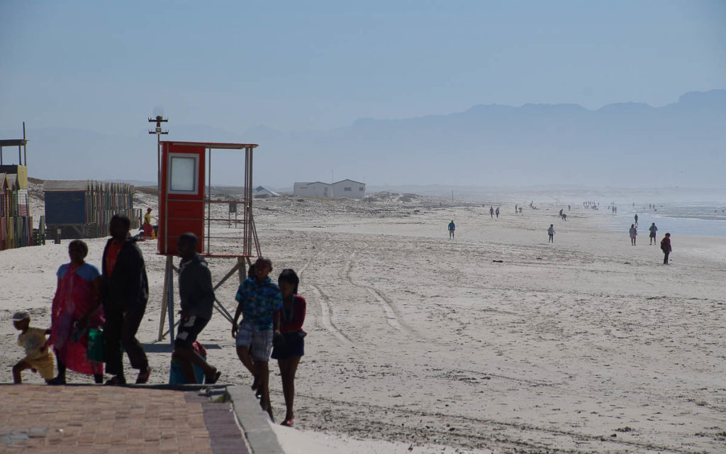 family leaving Muizenberg beach