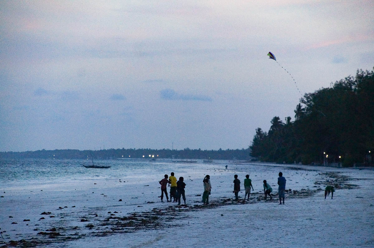kids playing at Matemwe beach while it is getting dark