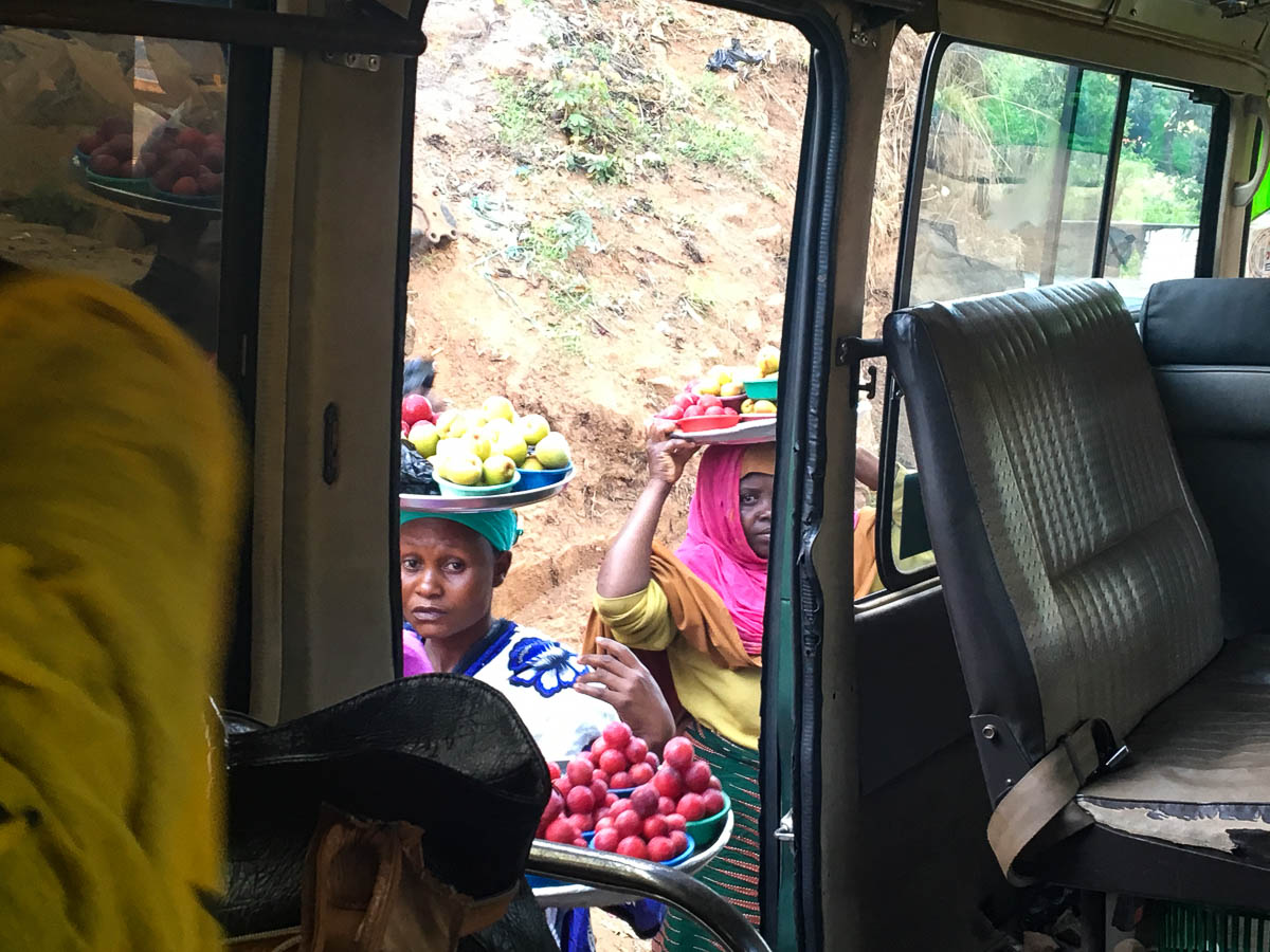 women selling fruits at bus in Lushoto