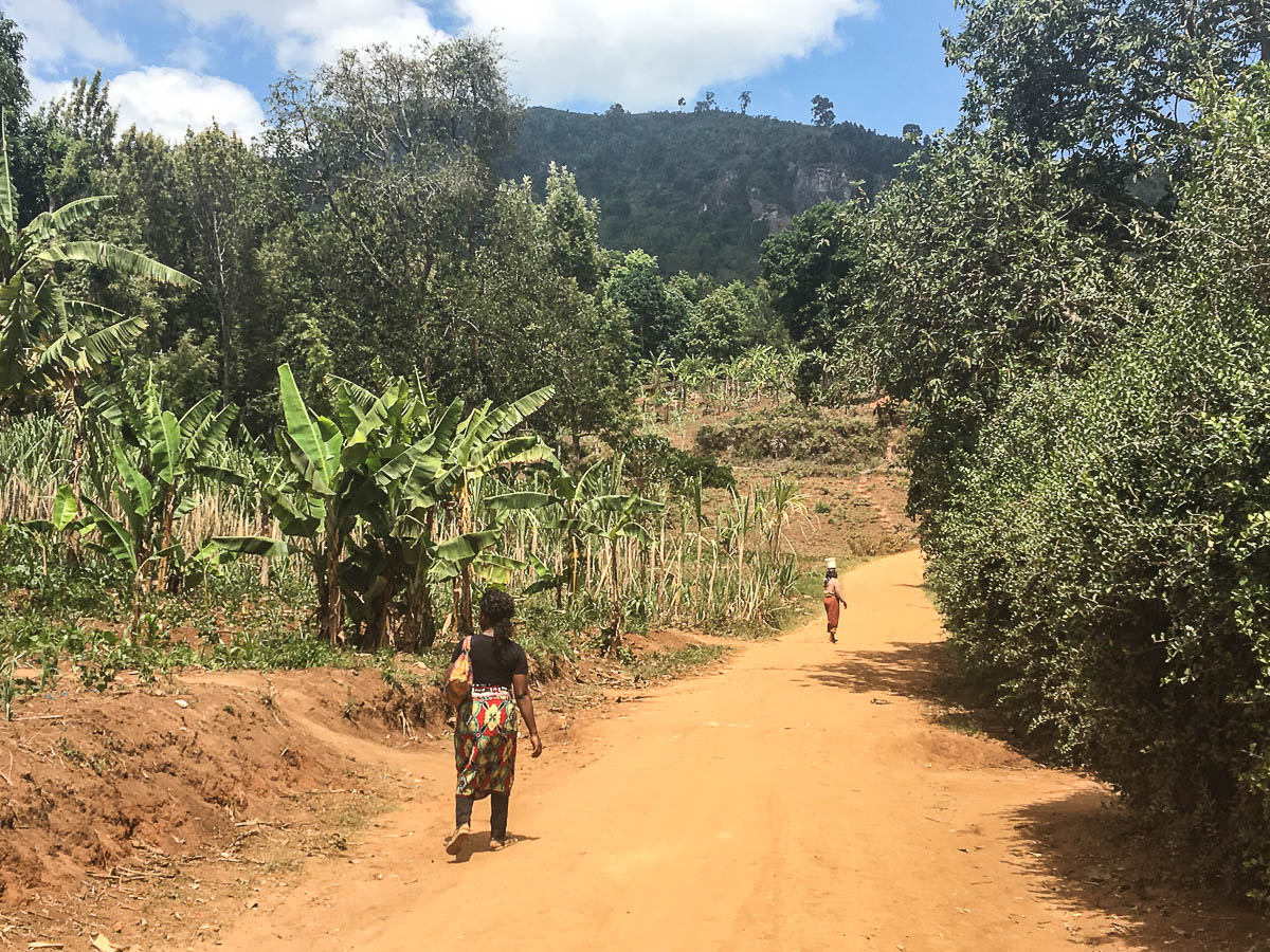 woman walking through Lushoto in Usambara mountains