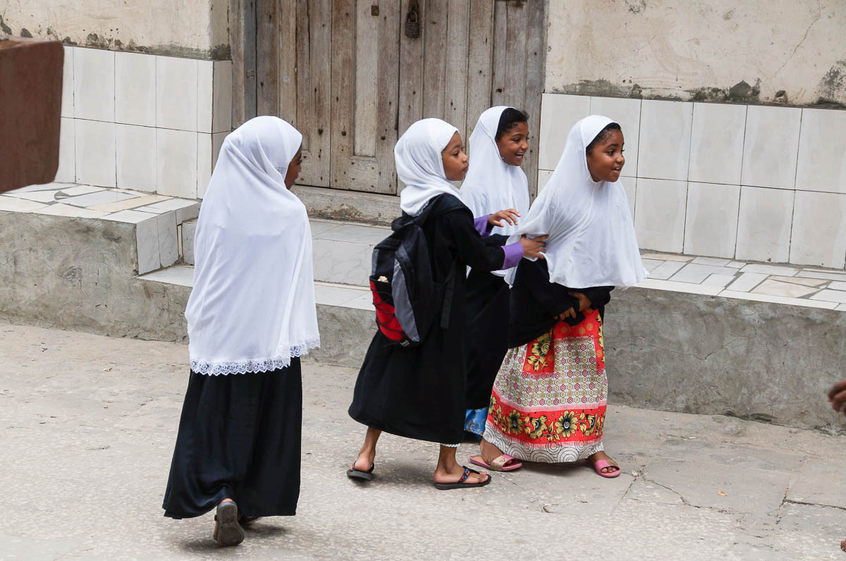 schoolgirls in streets of stonetown