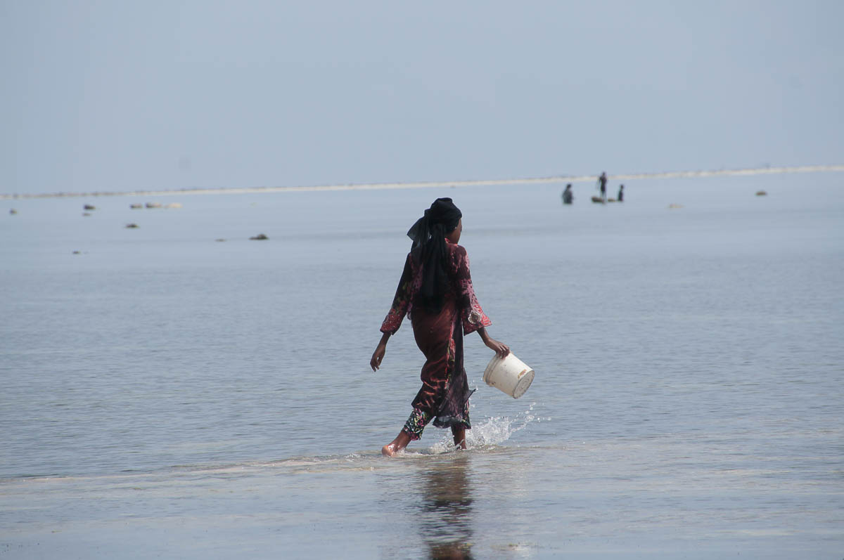 woman walking into the sea at Matemwe beach
