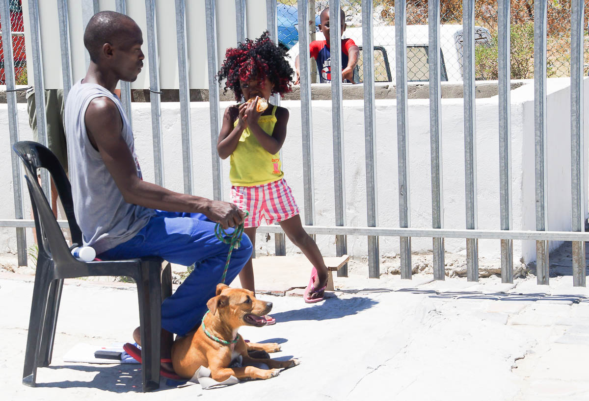 girl waiting with in dog in Kyaletisha