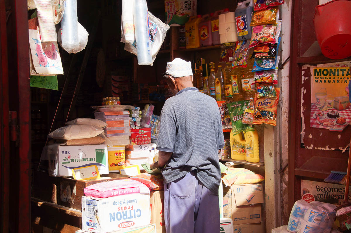 old man on Stonetown market in front of shop